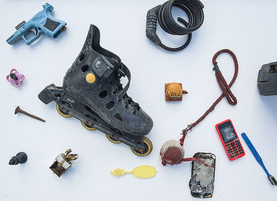 Items pulled out of The Thames Lodon - rollerskate, old toys, bike lock, phone, tootbrush, water pistol
