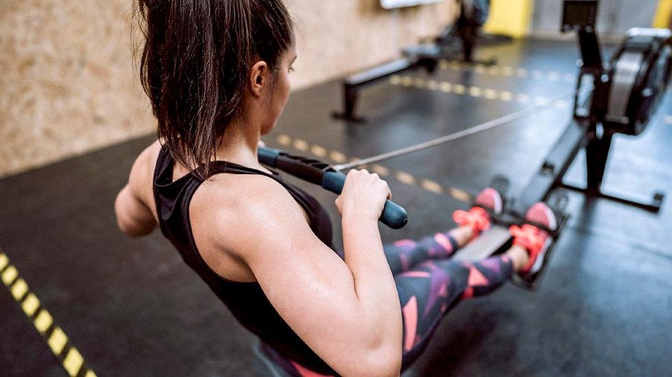 Young-Women-Having-Sports-Rowing-Trainin