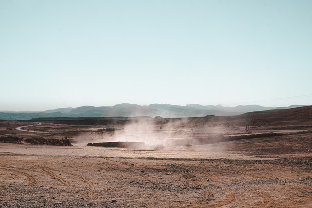 Moroccan desert landscape photography: Desert sand and dust | RollingBear Travels.
