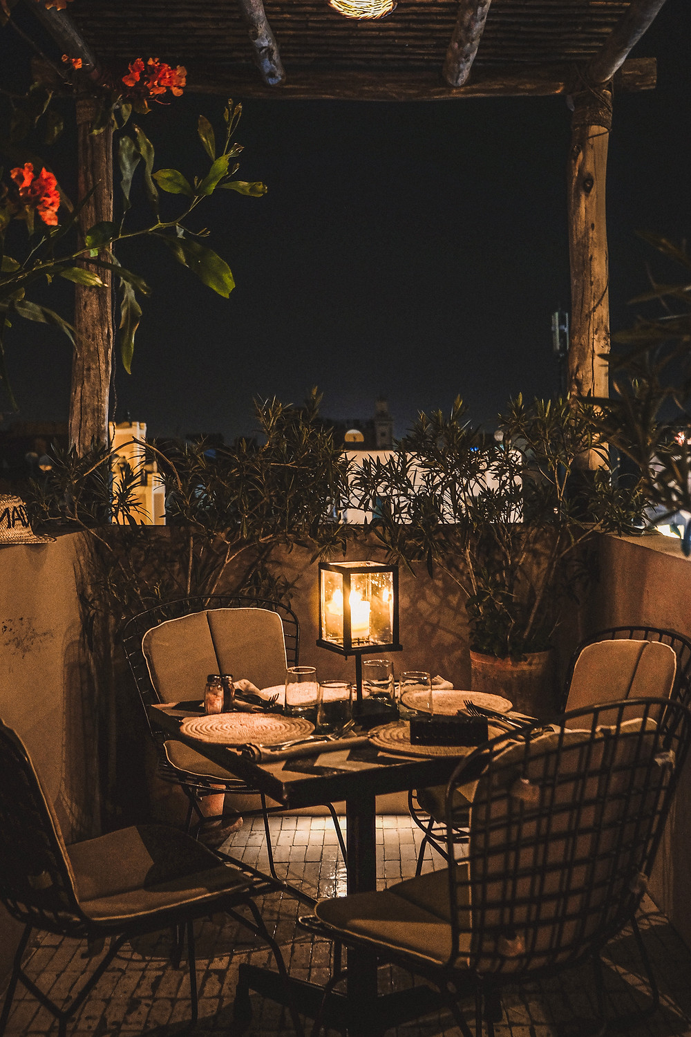Candlelit dinner table, rustic chic furniture of Nomad, Marrakech | RollingBear Travels