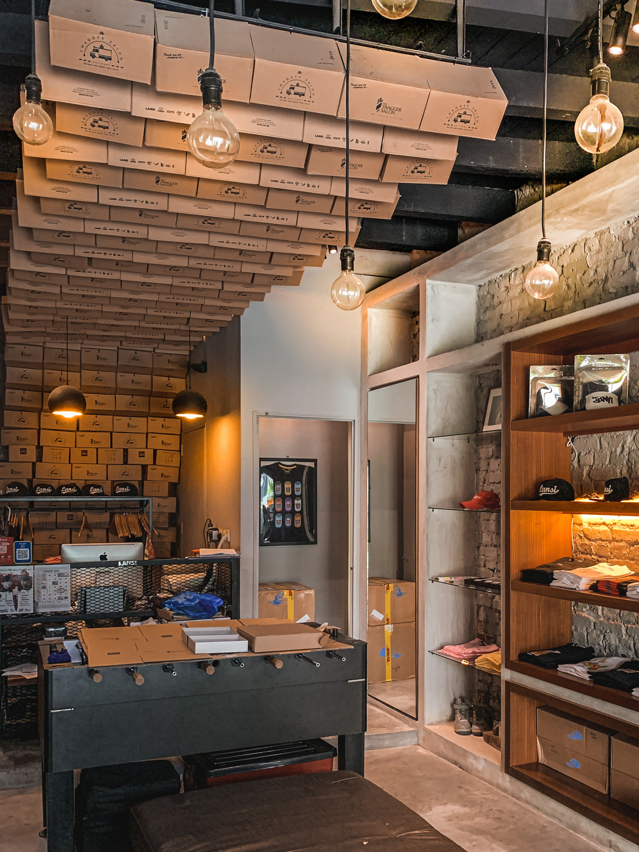 Industrial chic decor, wooden clothes shelves of The Swagger Salon, RollingBear Travels blog.