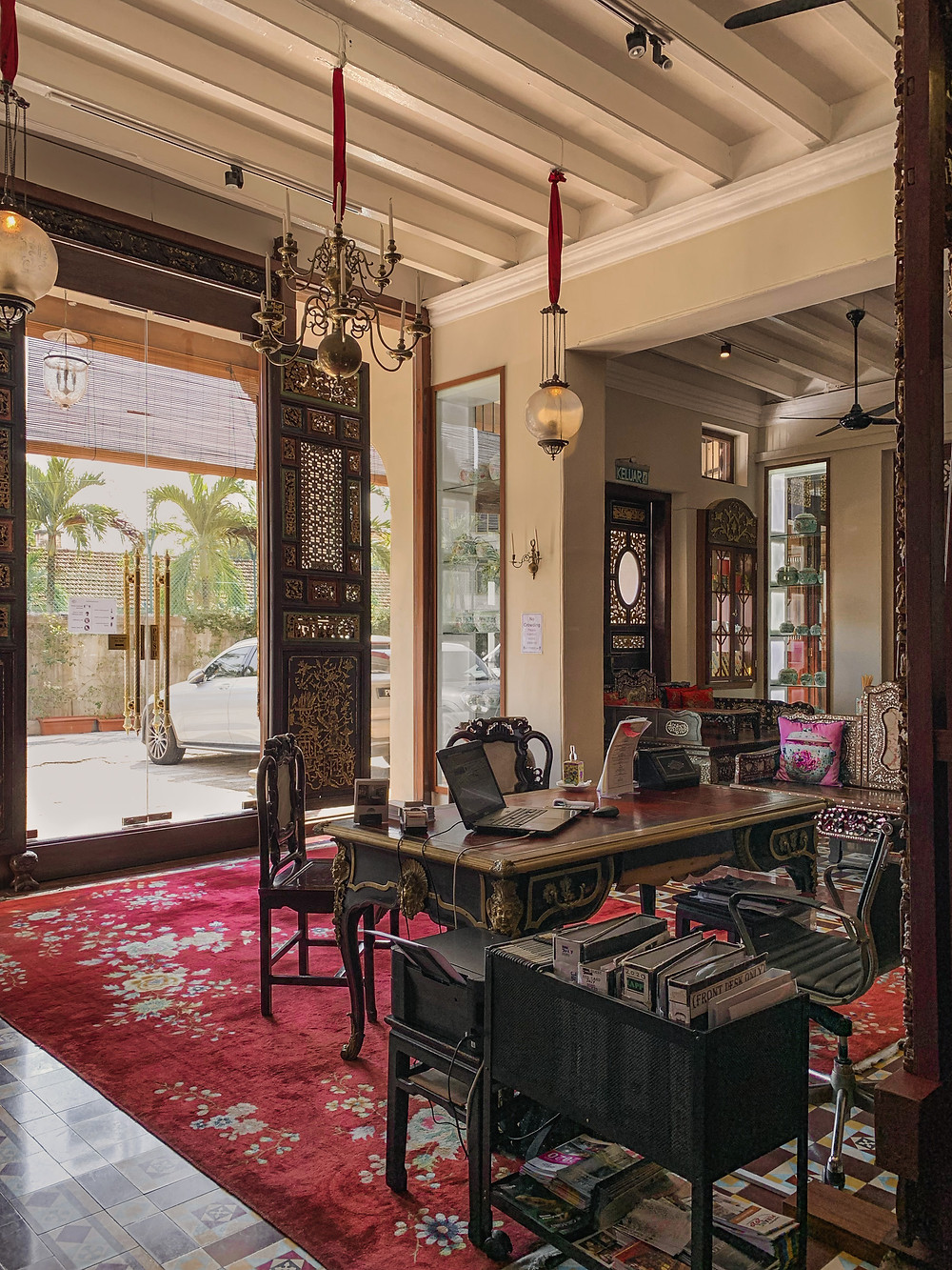 Antique Peranakan furniture at the Seven Terraces hotel reception, photography by RollingBear Travels.
