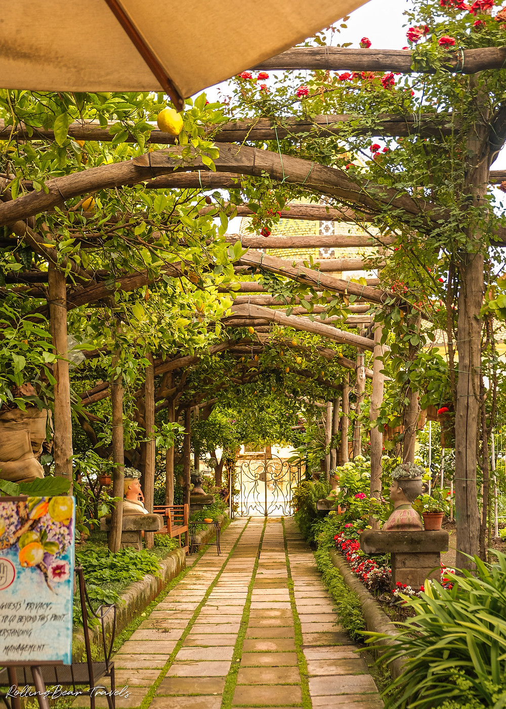 Al Palazzo restaurant ambience: Romantic garden stone walkway under vine-clad pergola | RollingBear Travels.
