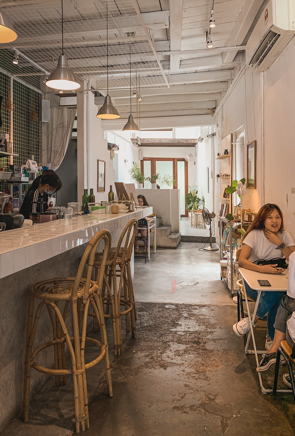 Narrow rustic interiors of Le楽 Cafe, RollingBear Travels photography.