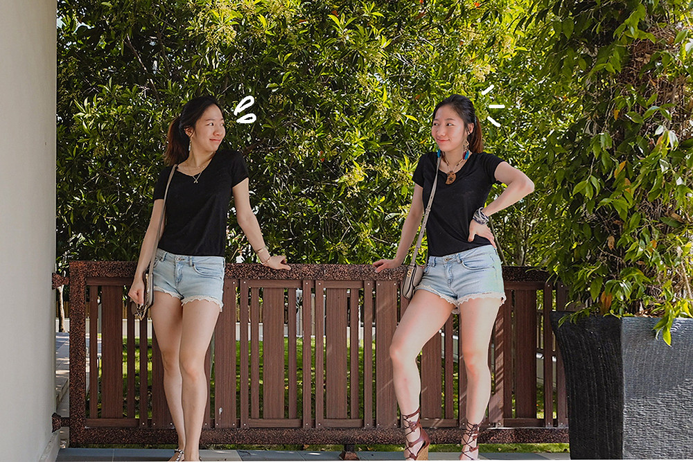 Black tshirt, faded blue denim shorts outfit styling by RollingBear Travels.