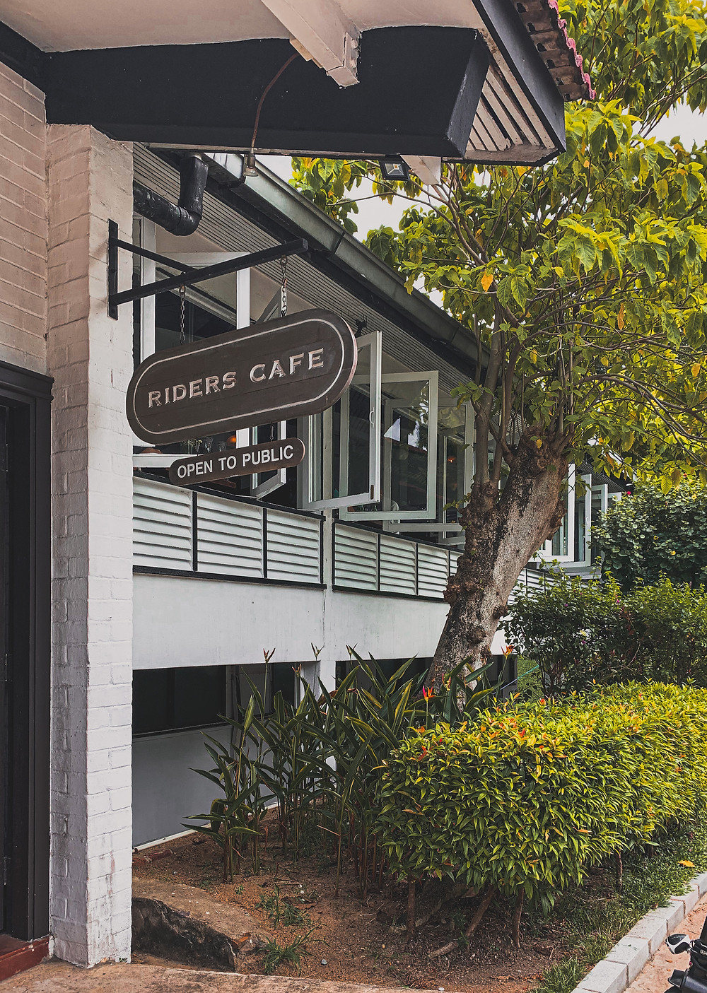 Rollingbear Travels blog/ Entrance to Riders Cafe, a heritage black-and-white-building in Bukit Timah, Singapore