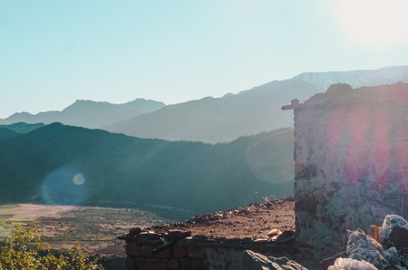 Ait-Ben-Haddou road trip photography: Earthen building silhouette against the Atlas Mountains, Morocco | RollingBear Travels.