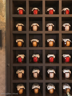 Oriental restaurant decor: Chinese tea jars on a grid of shelves | RollingBear Travels.