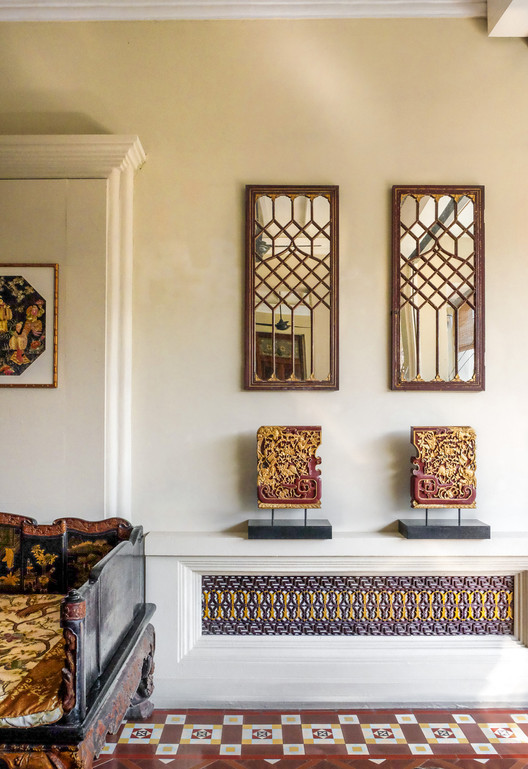 Peranakan motif mirrors, antique Chinese wall cabinet components displayed at Seven Terraces / RollingBear Travels blog.