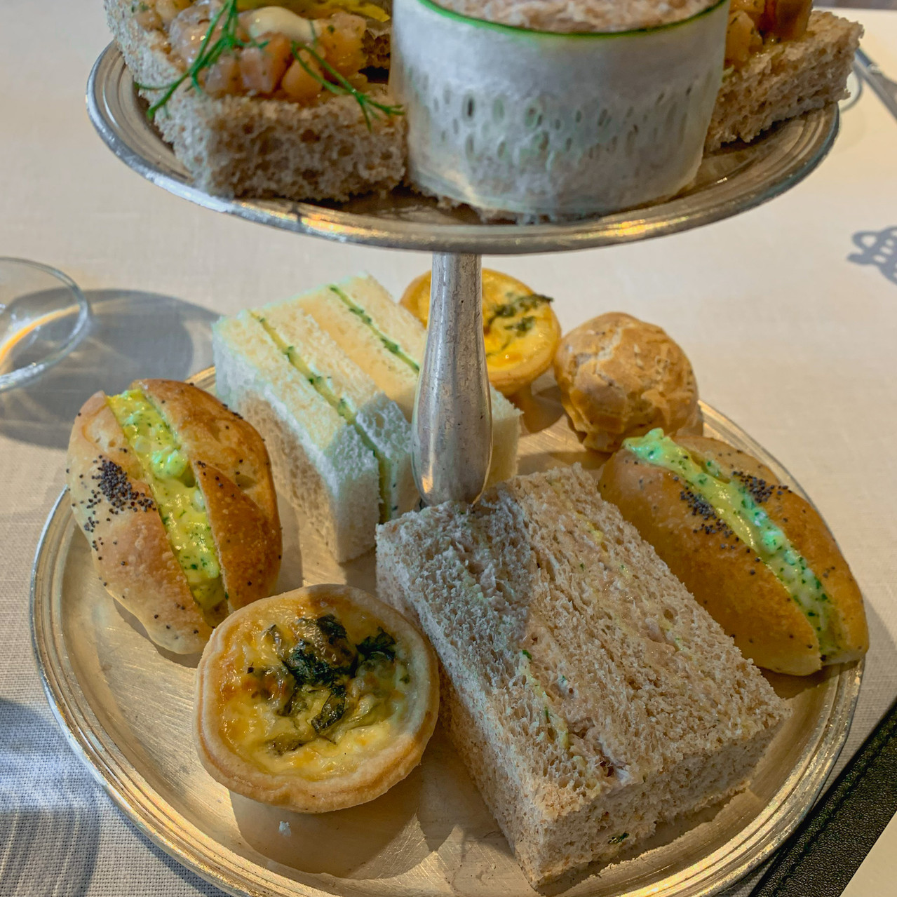 E&O Hotel afternoon tea: Assorted finger sandwiches on afternoon tea tray, RollingBear Travels blog.