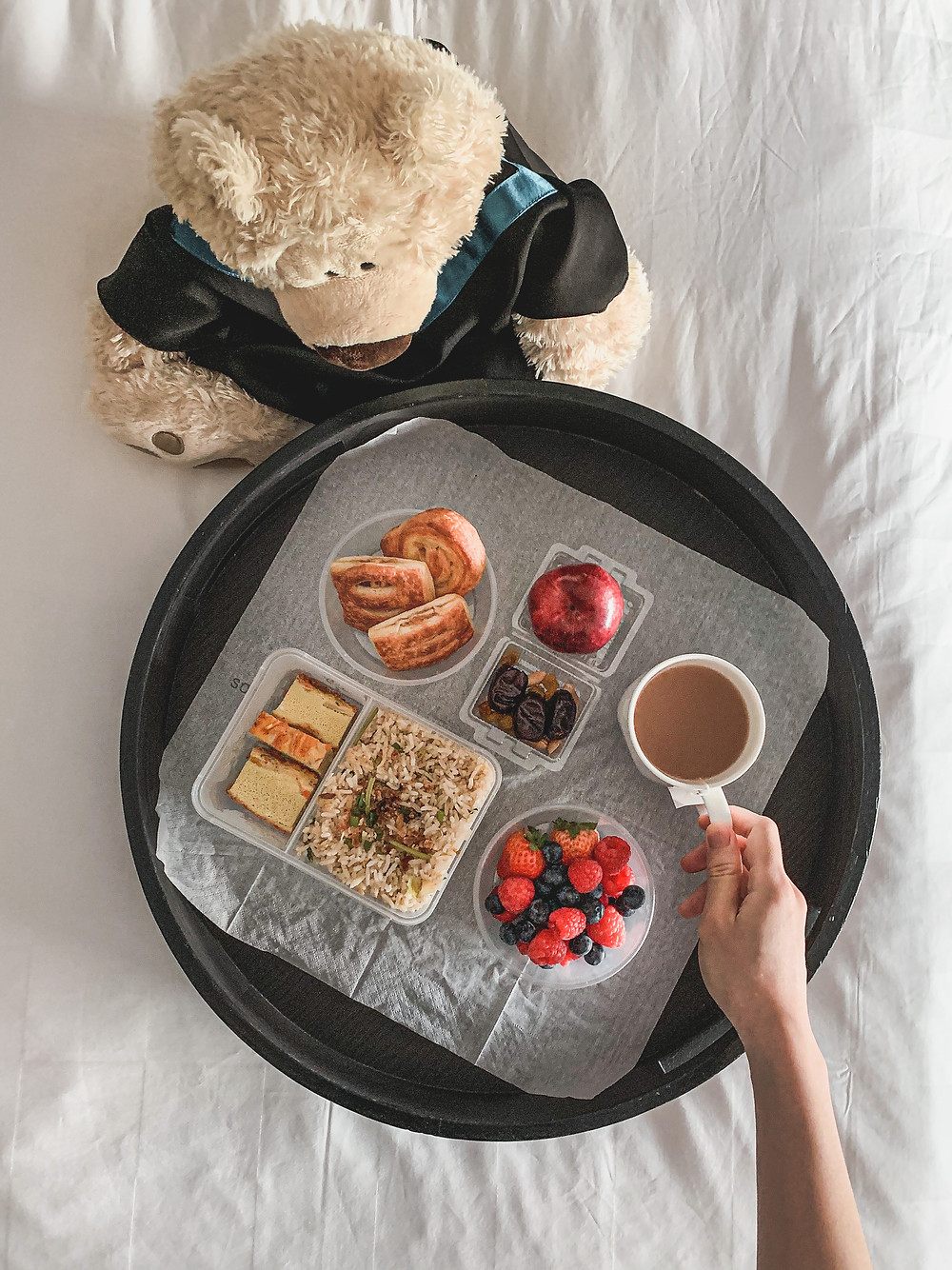 Rollingbear Travels blog/ Gund Philbin teddy bear, flat lay of quarantine breakfast spread in bed, Malaysian fried rice, mini pastries, mixed berries