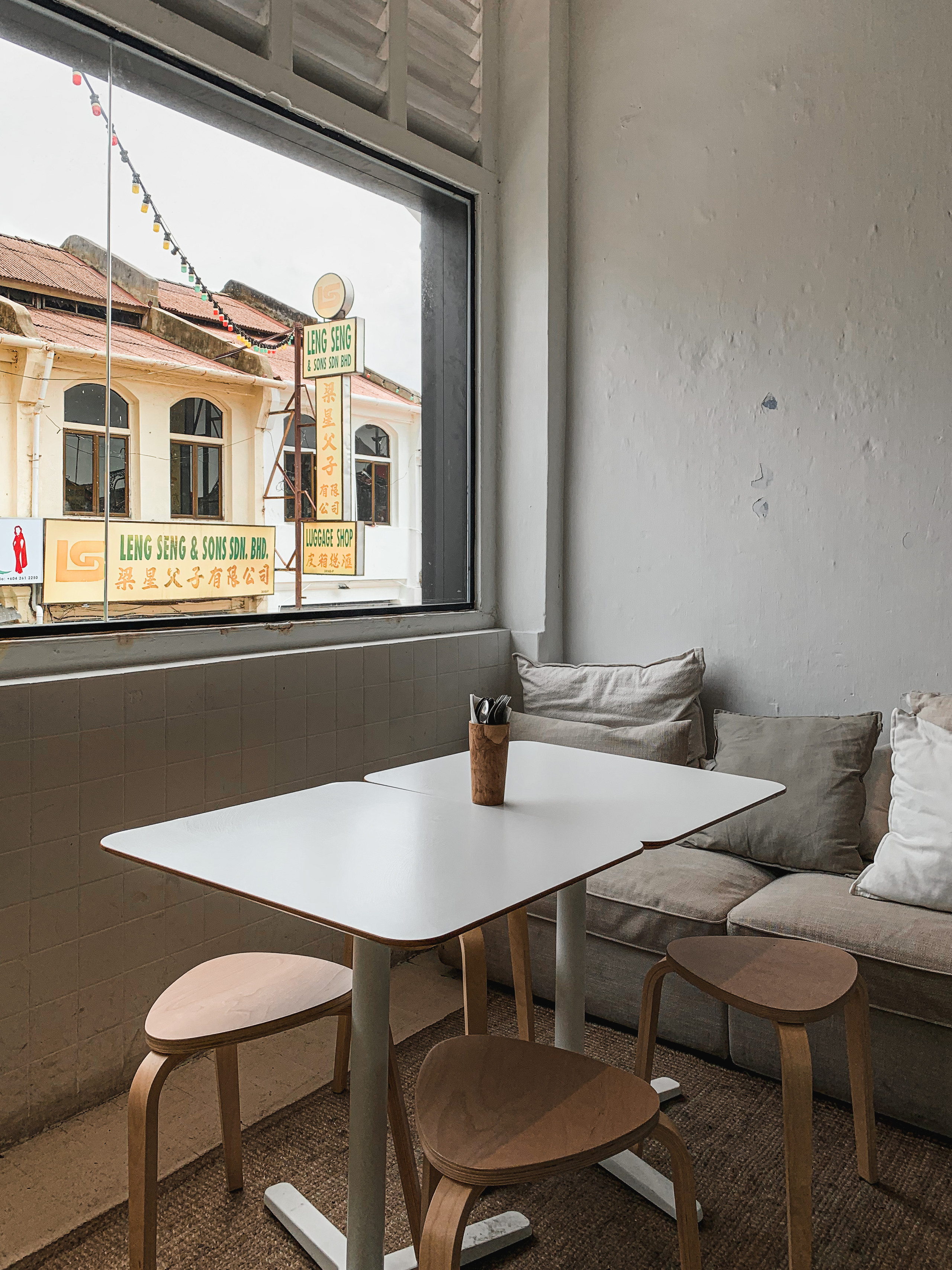Island Problems ambience: cosy, minimalistic Muji-style interiors and sofa | RollingBear Travels.