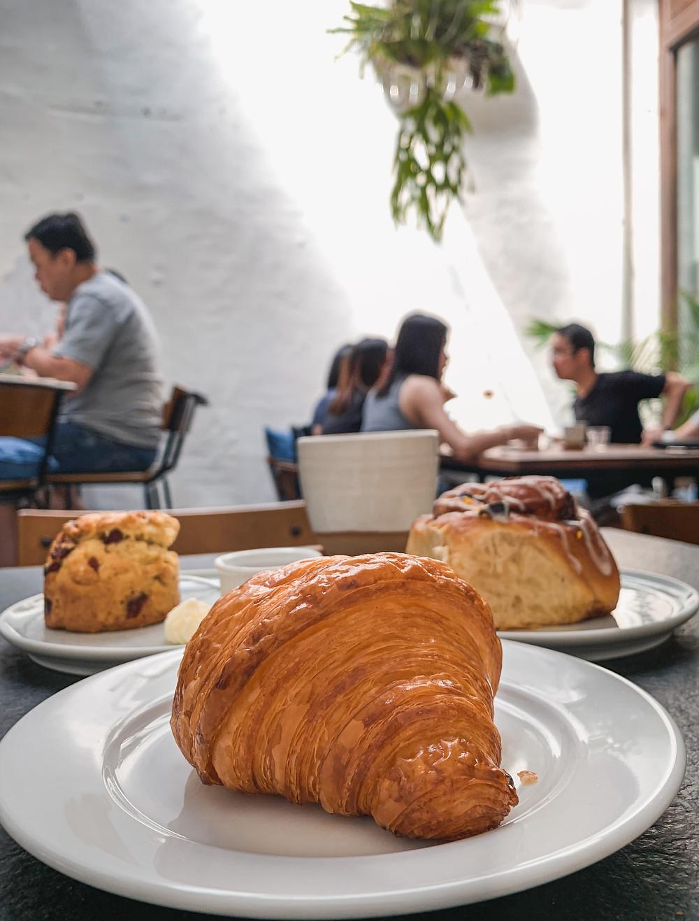 Le Petit Four Patisserie croissant, scone, cinnamon roll, RollingBear Travels food photography.