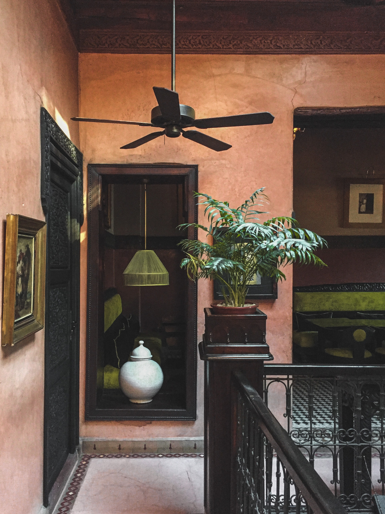 Coral walls, timber balustrades, Moroccan riad decor | RollingBear Travels