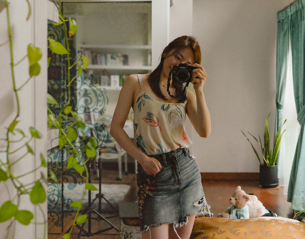 Mirror selfie of floral camisole and denim skirt outfit, RollingBear Travels blog.