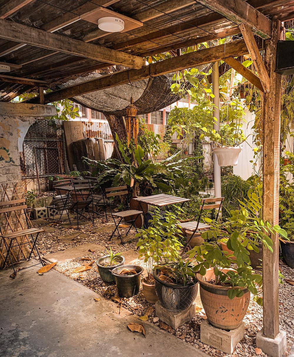 Rustic timber shelter, wooden picnic furniture, Hin Bus Depot garden deck, RollingBear Travels blog.