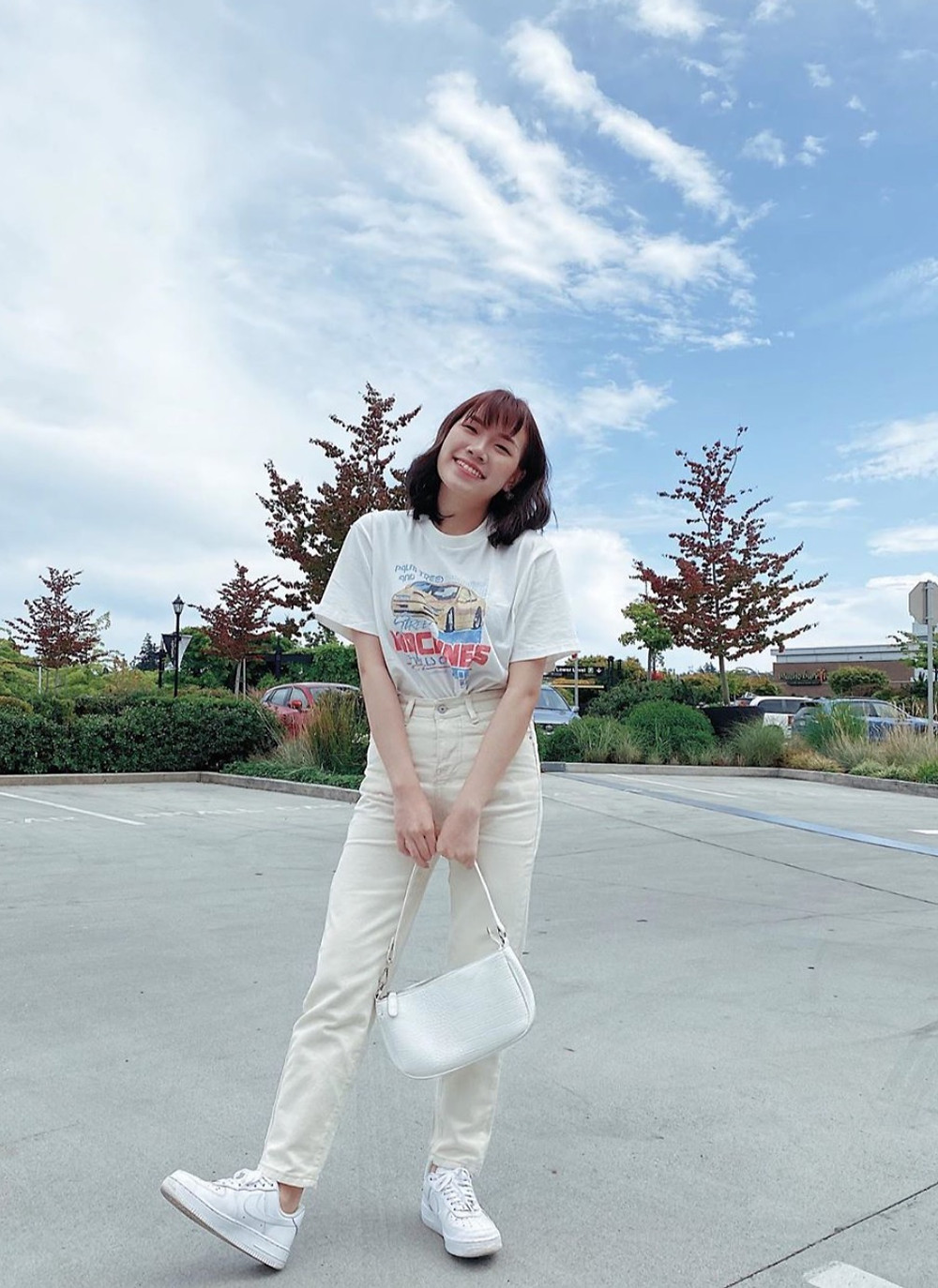 White summer outfit : Graphic tee, jeans, sneakers, purse, by build_a_brina, RollingBear Travels blog.