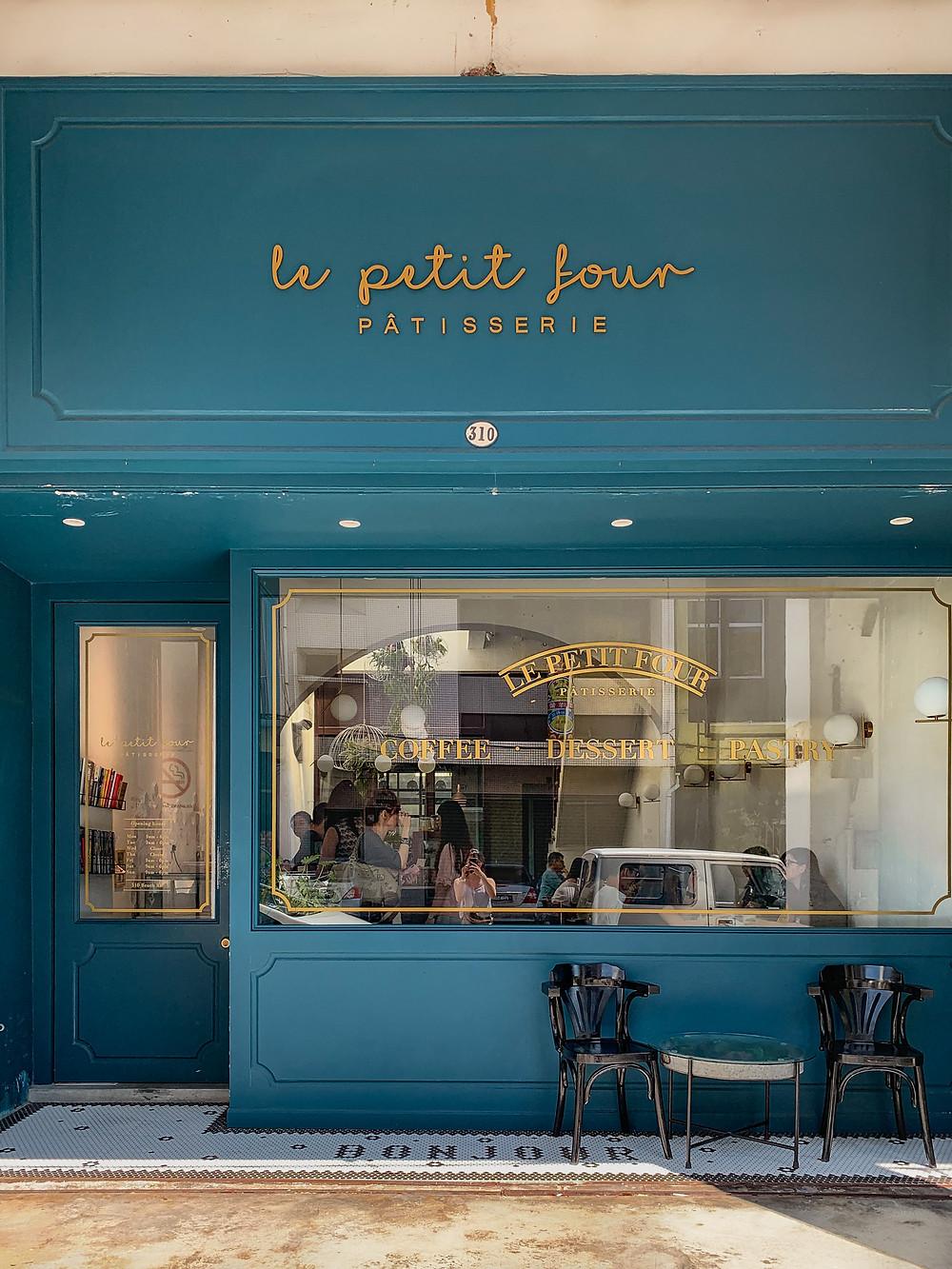 Le Petit Four Patisserie Review, blue cafe facade, RollingBear Travels blog.