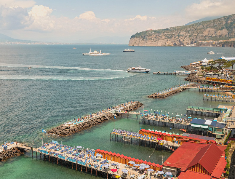 Top view of boats approaching the Marina Grande pier, Sorrento | RollingBear Travels.