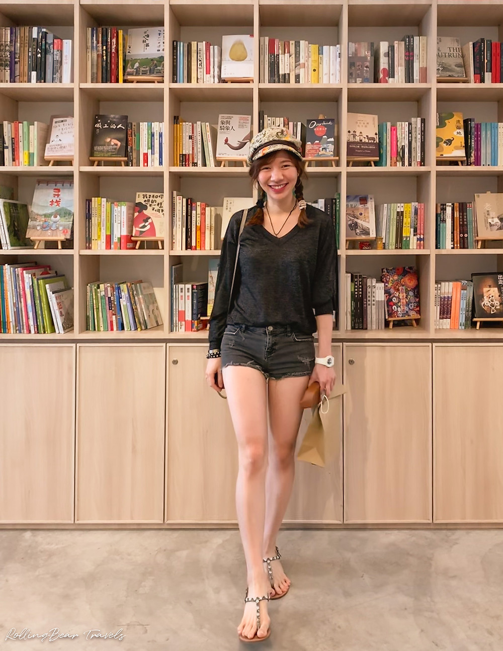Style blogger in a Zadig & Voltaire shimmery summer sweater, ripped black denim shorts, sandals, vintage cap | RollingBear Travels.