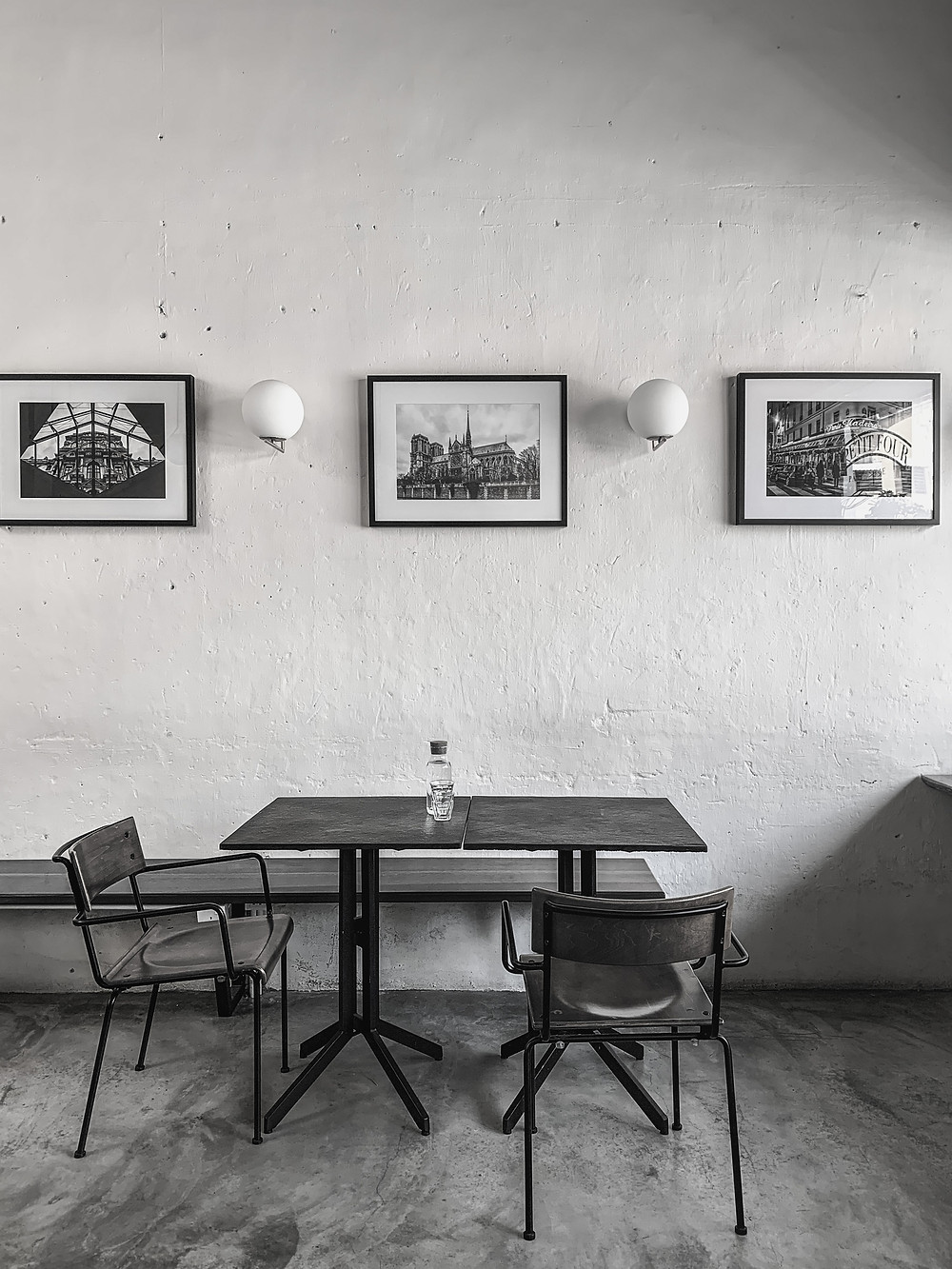 Black & white interior photography: Modern cafe decor of Le Petit Four Patisserie, RollingBear Travels blog.