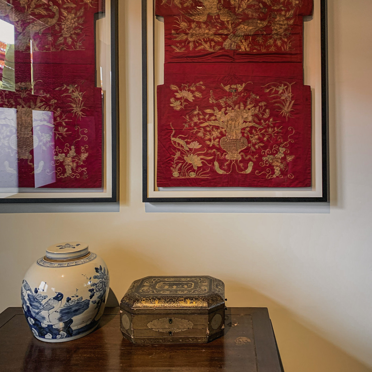 Seven Terraces room decor: Framed embroidered Peranakan chair covers, antique chinoiserie vase and box / RollingBear Travels.