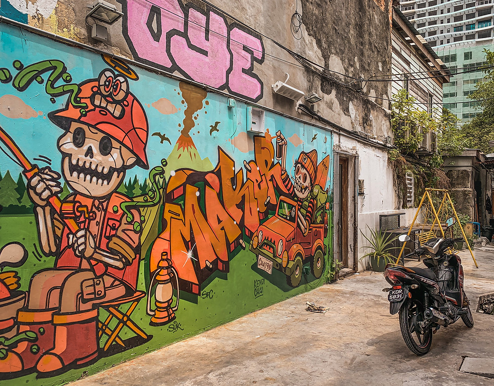Colourful street art mural and a motorcycle at the narrow lane of Le Cafe, RollingBear Travels blog.