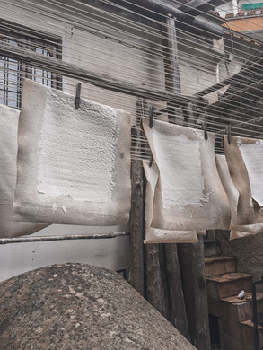 Paper hung to dry at the Amalfi Paper Museum | RollingBear Travels.