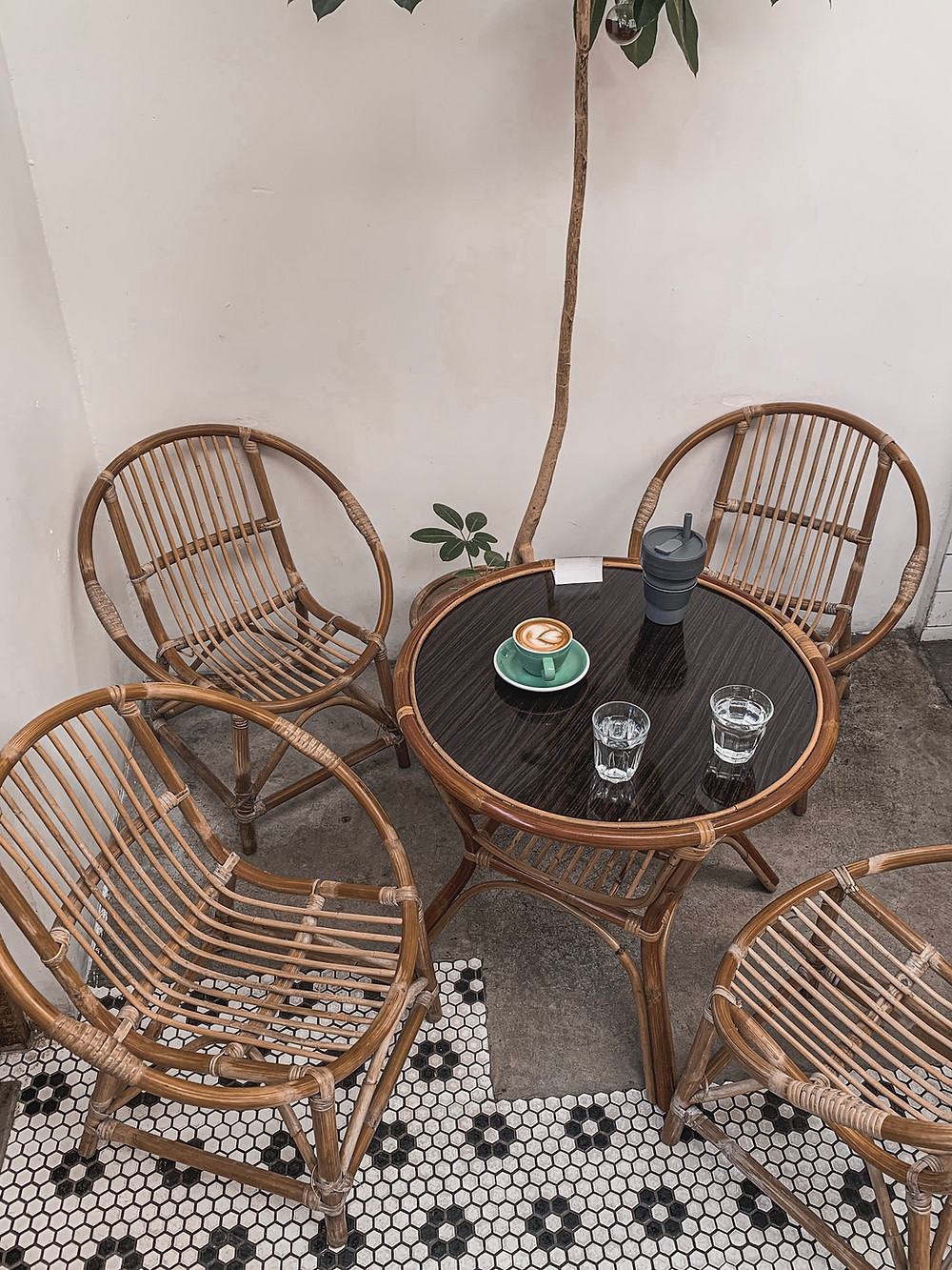 Norm Penang interiors: traditional rattan furniture, patterned Chinese tiles, RollingBear Travels.
