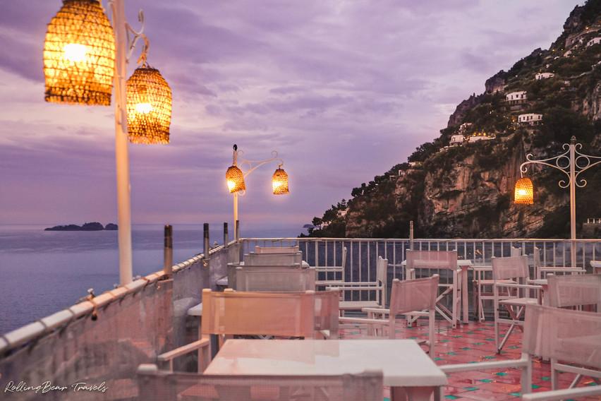 Straw lanterns illuminate the white furniture of il Capitano's tiled terrace | RollingBear Travels.