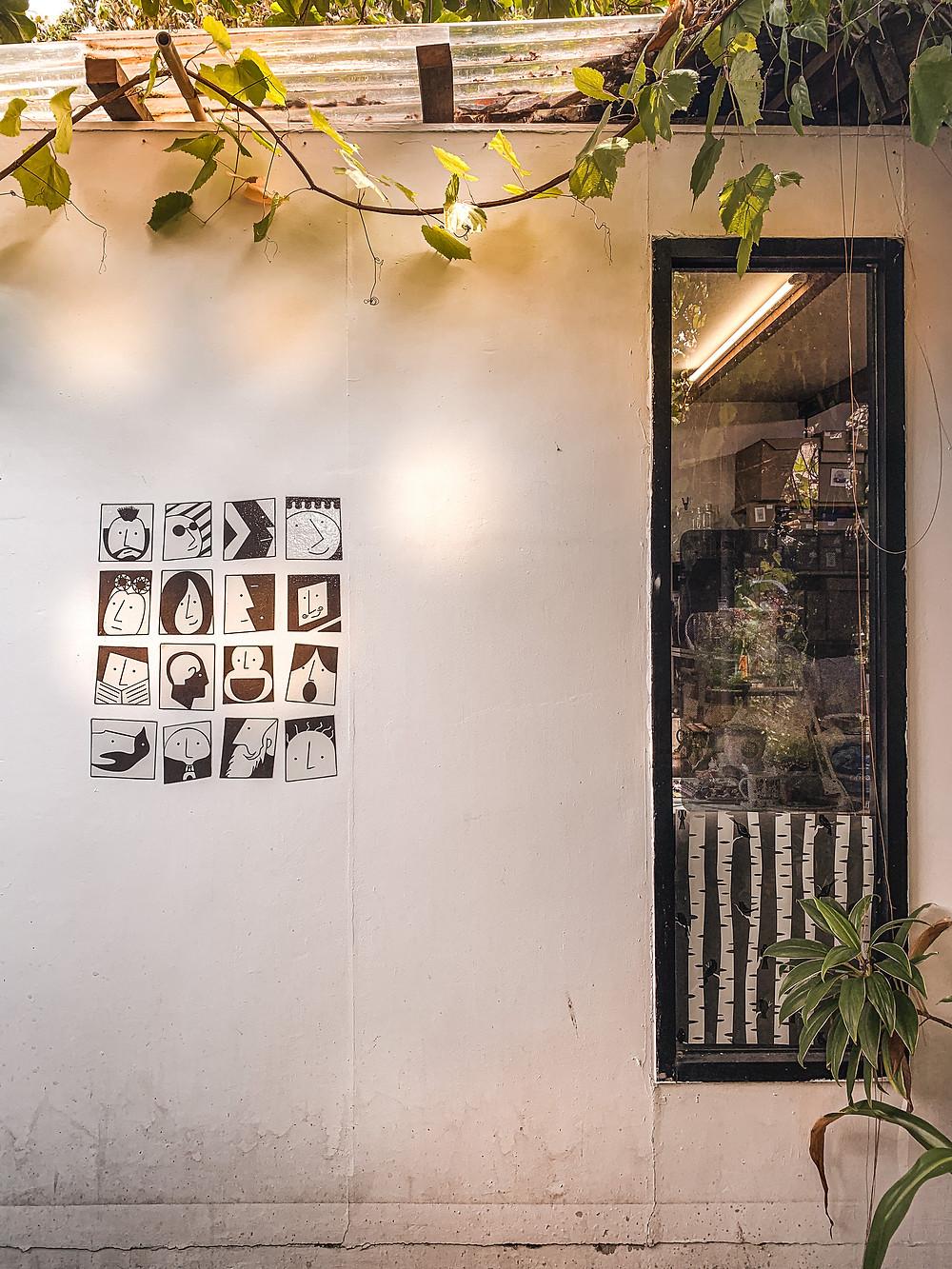 Doodle wall art and rectangular black window facade of KIWE, Penang, RollingBear Travels blog.