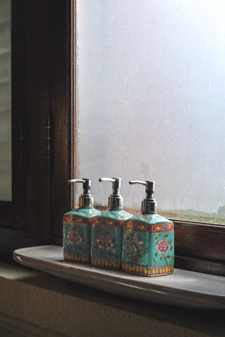 Turquoise porcelain chinoiserie bottles by the window sill / RollingBear Travels photography.