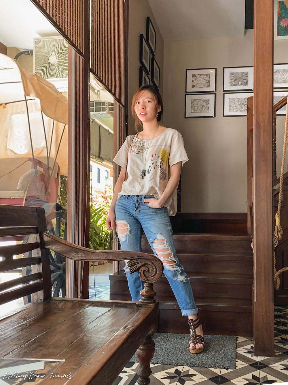Style blogger in an oversized graphic tee, Hollister ripped boyfriend jeans, leather wedges, long chain necklace   RollingBear Travels.