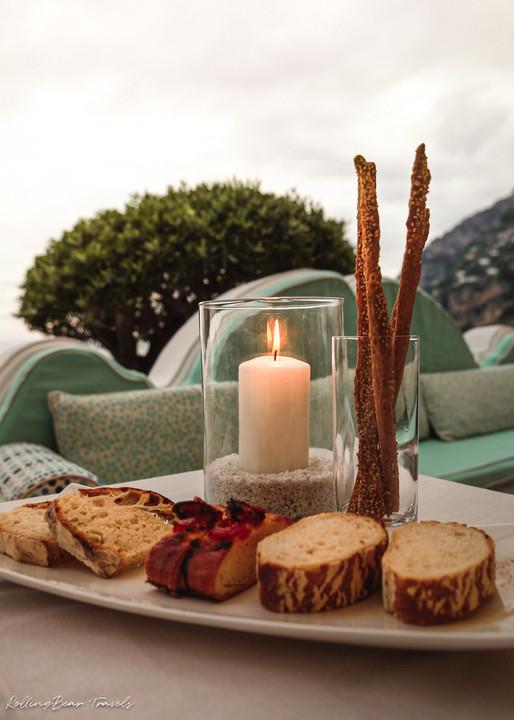 Terrazza Celè Restaurant ambience: a platter of bruschetta, breadsticks and a candle | RollingBear Travels.