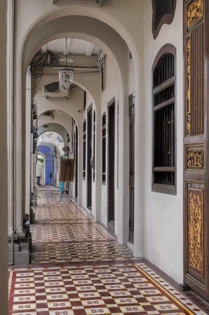 Peranakan timber doors and comb windows along back entrance of the Seven Terraces Hotel, RollingBear Travels photography.