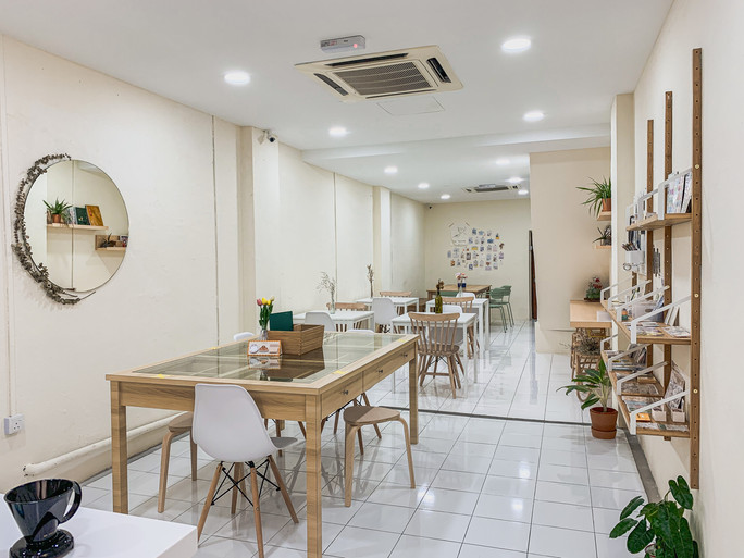 Clean white minimalistic interiors of Haru Stationery Cafe, Penang | RollingBear Travels.