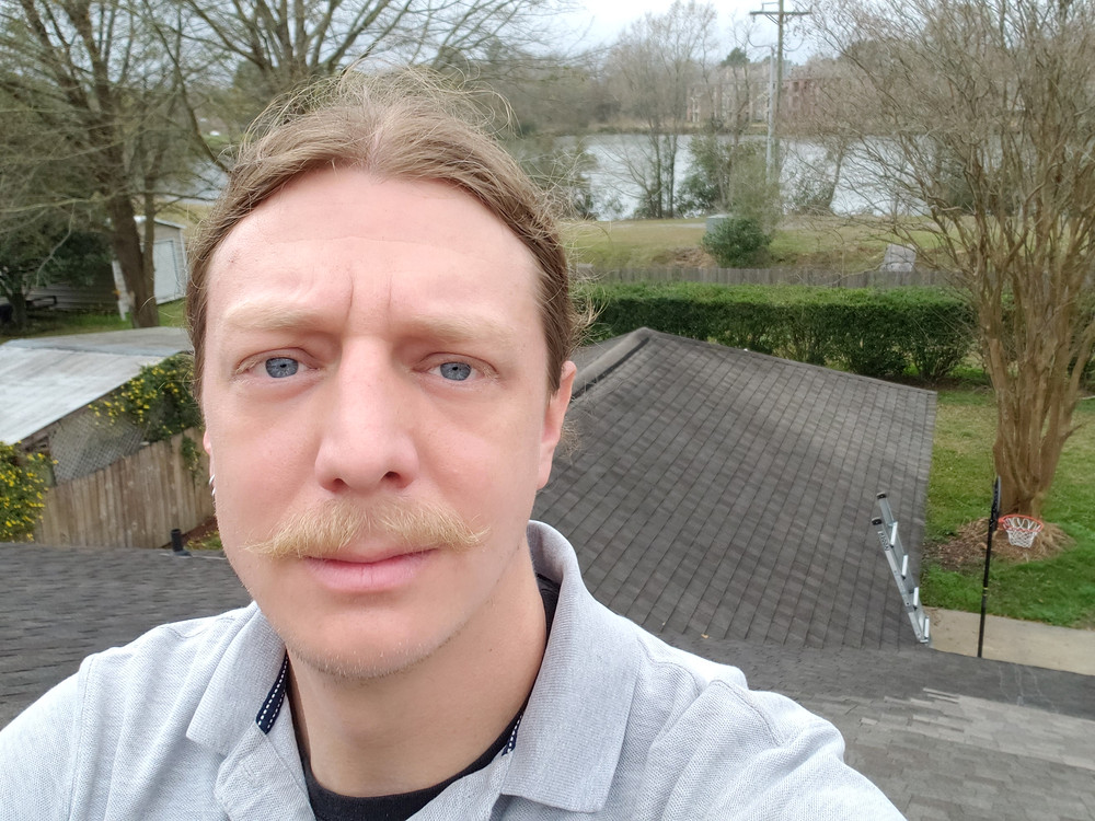 Home Inspector on a roof.