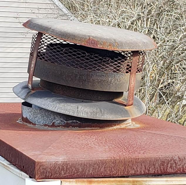 Damaged chimney cap
