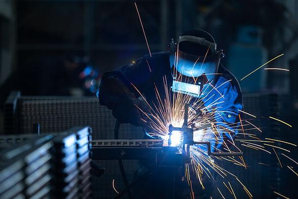 workers-wearing-industrial-uniforms-welded-iron-mask-steel-welding-plants.jpg