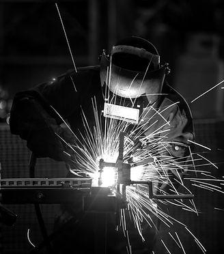 workers-wearing-industrial-uniforms-welded-iron-mask-steel-welding-plants_edited_edited.jp