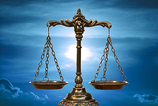 A photo of the scales of justice with a