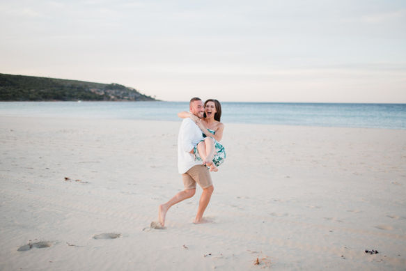 Playful couple on the beach for these photos in Margaret River