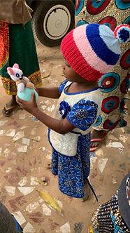 Child holding toy.jpg