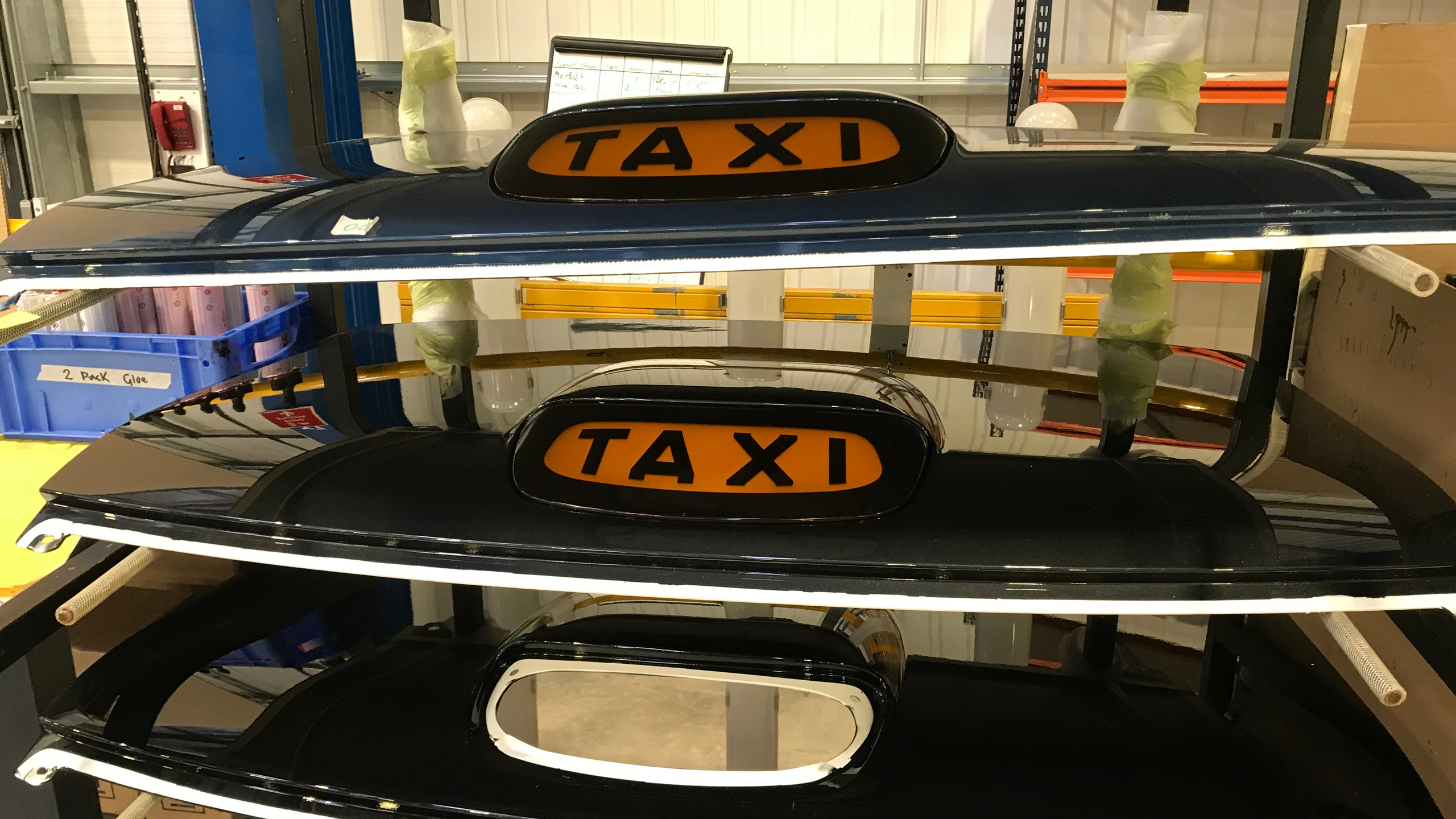 The illuminated light is 'glued' on to panels ready to be attached to the frame of the taxi.