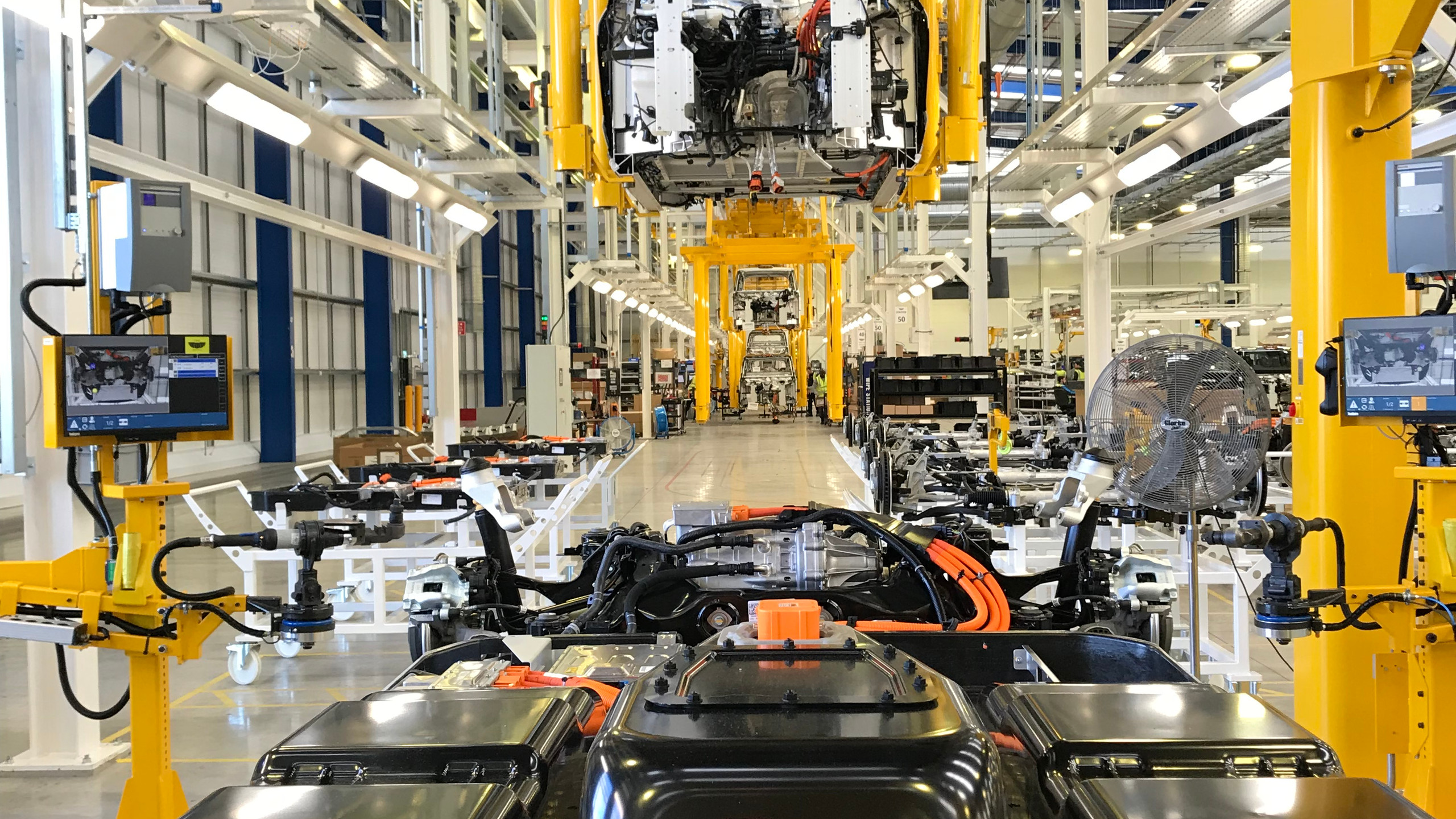 The aluminium chassis now moves on to an area of the production line where the battery, wheels and motor await.