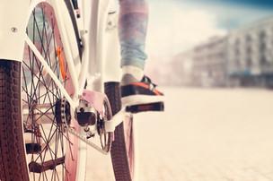riding bike on a boardwalk