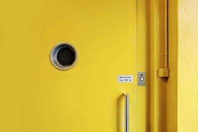Behind the Yellow Door