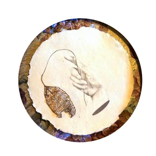 Platinum palladium print on handmade paper with pressed apple leaf and pencil