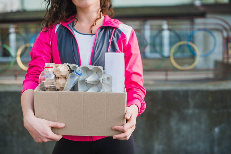 close-up-of-woman-holding-recycle-cardbo