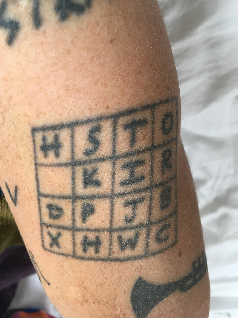 A tattoo like a crossword with letters